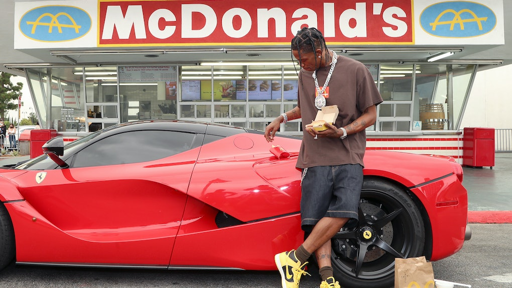 Travis Scott celebrates his new Travis Scott meal launch at Mcdonald's.