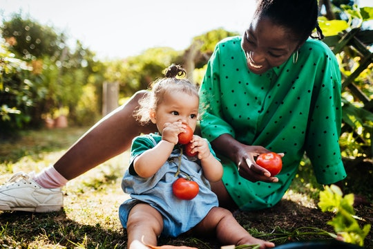 baby girl and mom in garden