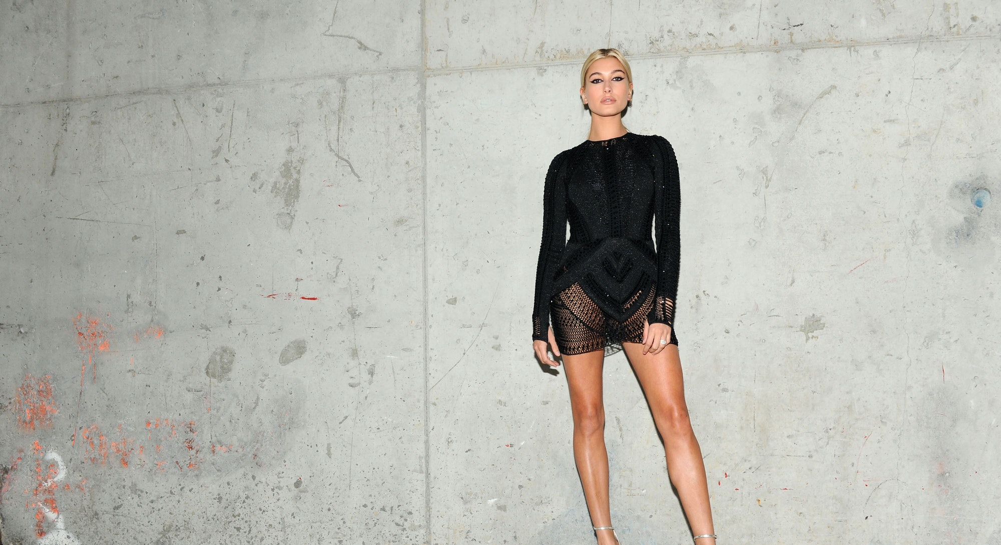 Hailey Bieber poses on red carpet