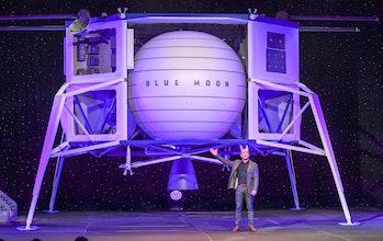 Amazon CEO Jeff Bezos stands beside the Blue Origin lunar lander.