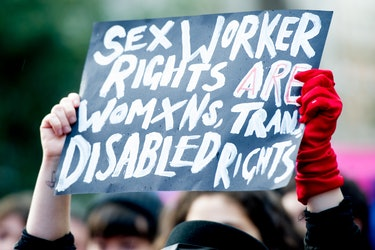 "A sign at a protest saying ""Sex worker rights are womxns, Trans, disabled rights."""