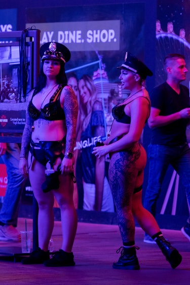 Two women in underwear and police hats.