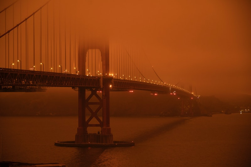 San Fransisco's Golden Gate Bridge in orange wildfire haze. Here's how to support wildfire relief efforts in California, Oregon, or Washington.