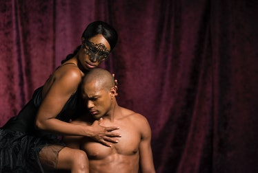 A Black man and woman embracing.