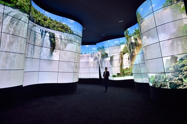 A giant wall of curved TVs.