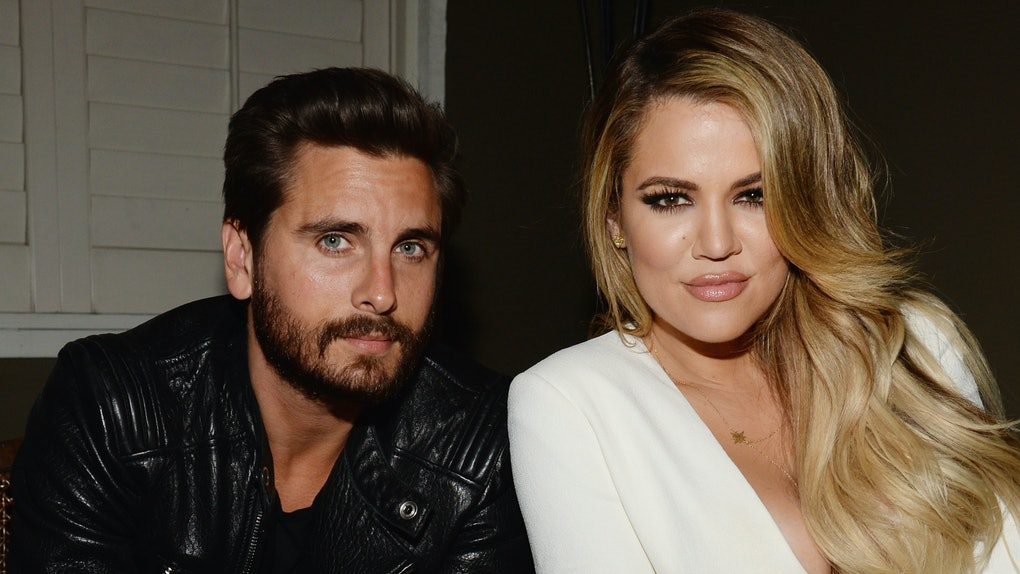 Scott Disick and Khloe Kardashian pose for a photo.