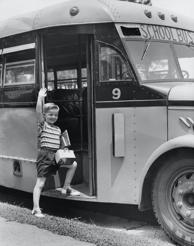 This vintage back to school photo is a priceless example of first day excitement.