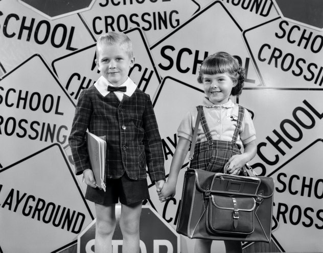 This vintage back to school photo features an adorable school-themed background.