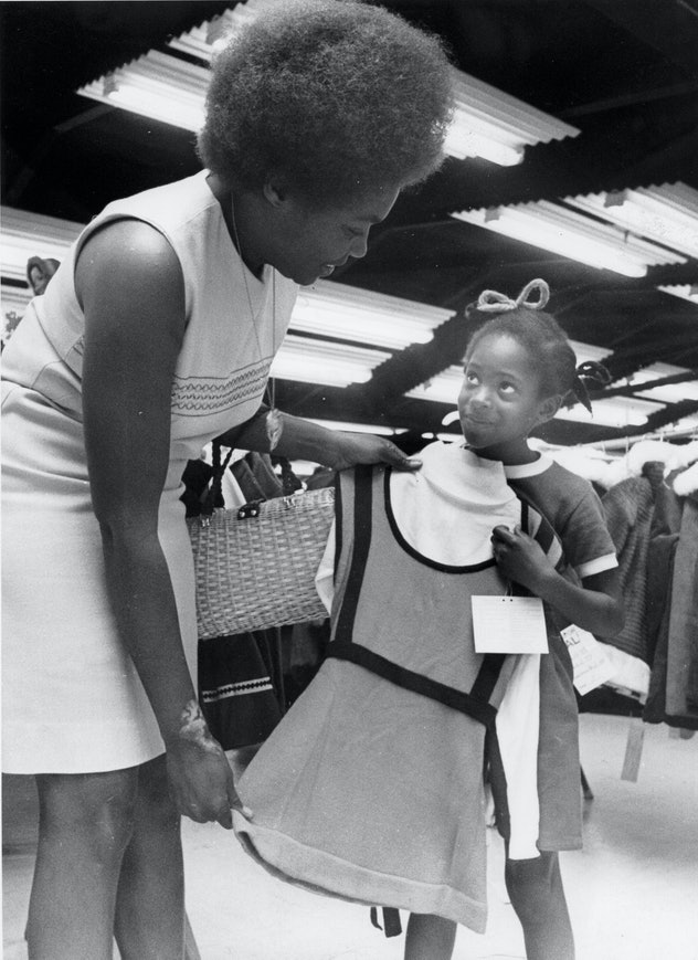 This vintage back to school photo shows a mom and daughter shopping for school clothes.