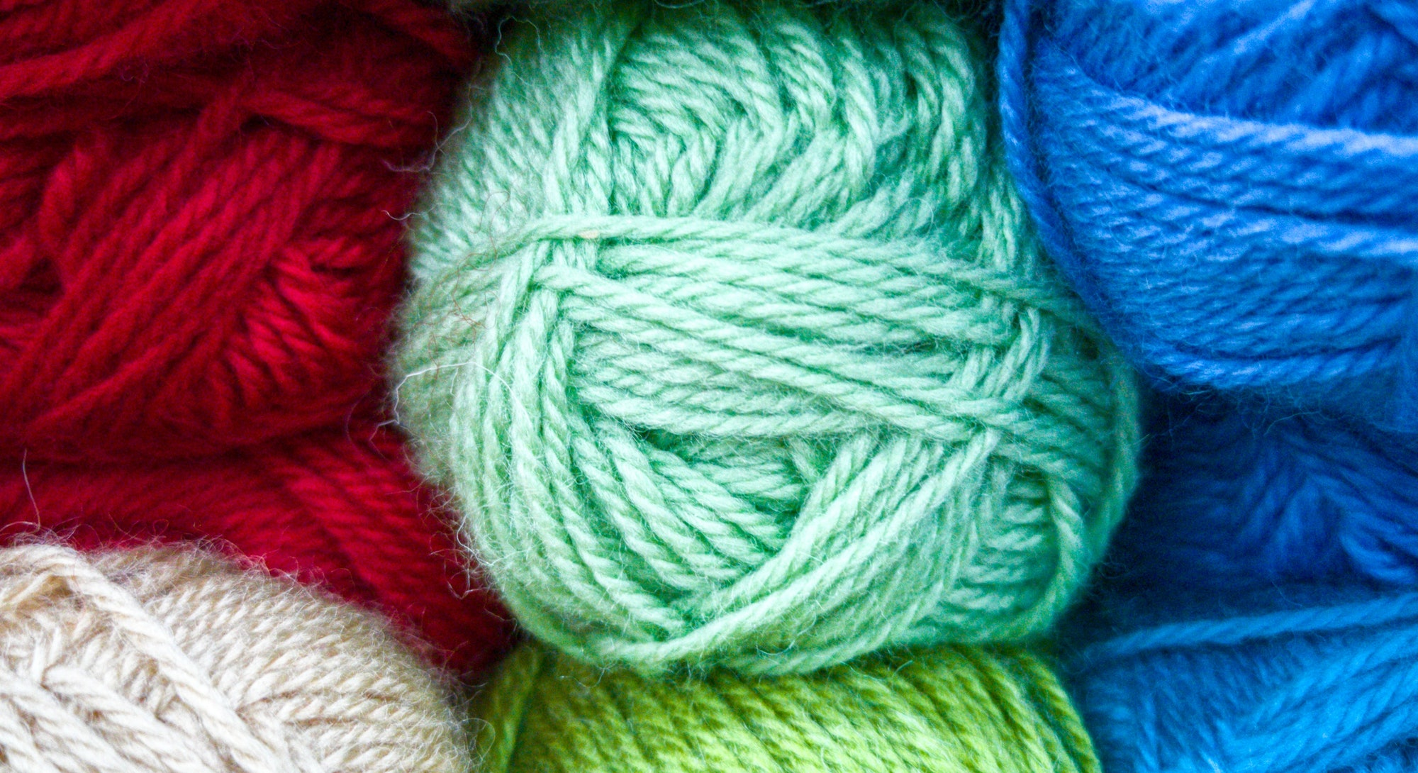 A close up of balls of yarn. This article details pandemic hobbies to do during the winter.