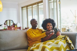 couple watching tv on couch