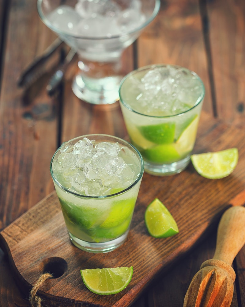 Vodka sodas with lime on a serving board. Doctors explain how white claw vs. vodka soda affect your body