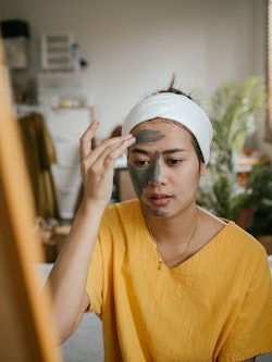 A woman applies a facemask while hungover. How does a hangover affect your body? Doctors have answer...