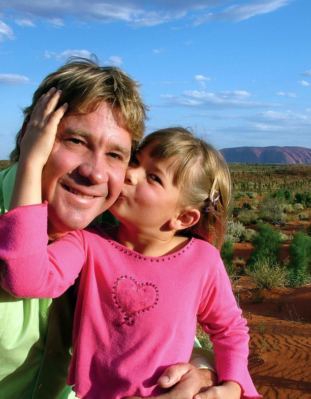 Bindi Irwin kisses her dad's cheek.