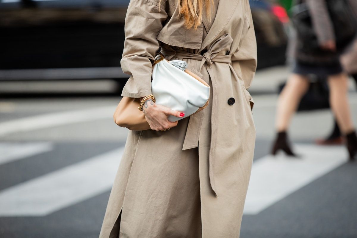 Pernille Teisbaek seen wearing brown trench coat, bag outside Stella McCartney during Paris Fashion Week Womenswear Spring Summer 2020 on September 30, 2019 in Paris, France.