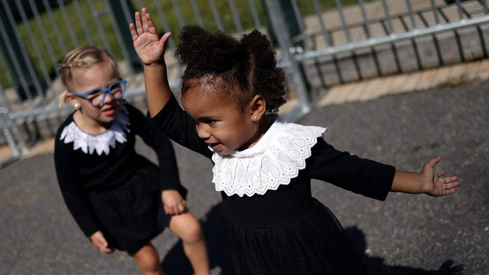 Across social media, parents have paid tribute to Ruth Bader Ginsburg by sharing photos of their children dressed as the late Supreme Court justice.
