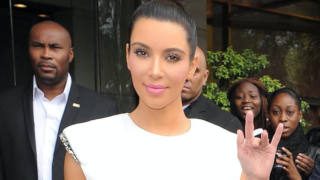Kim Kardashian steps out in a white body con dress.