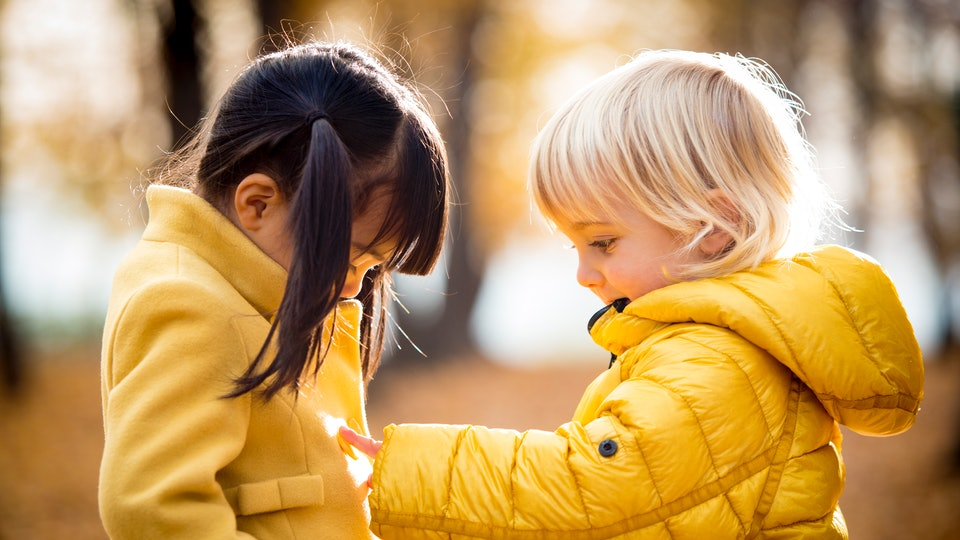 two little girls in yellow fall jackets