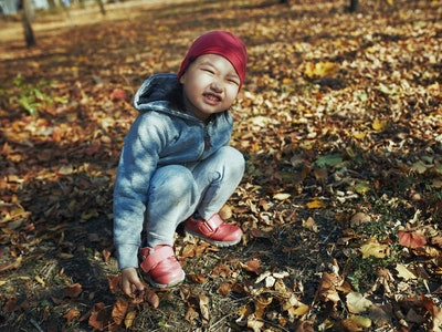 little girl in fall outside