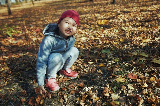 little girl in fall outside