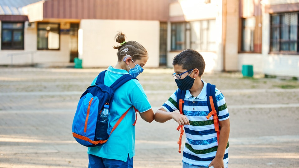 There are plenty of contact-free ways kids can greet their friends and teachers at school.