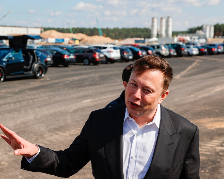 Elon Musk speaks to bystanders near Berlin, Germany.