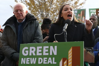 """Alexandria Ocasio-Cortez and Bernie Sanders promoting the Green New Deal, which Biden claimed not to support in the debate but calls """"crucial"""" on his website."""