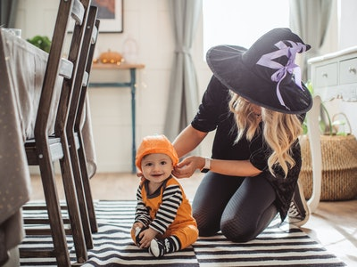mom getting baby ready to go out for halloween
