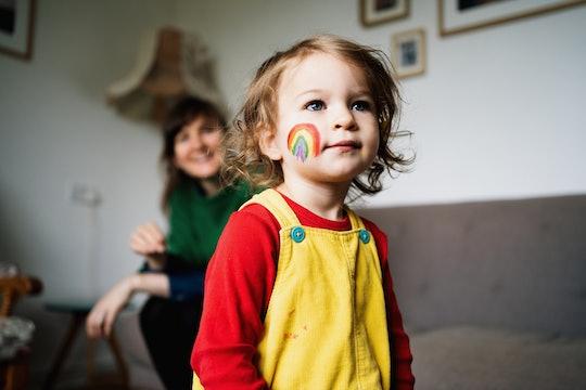 little girl with rainbow on cheek