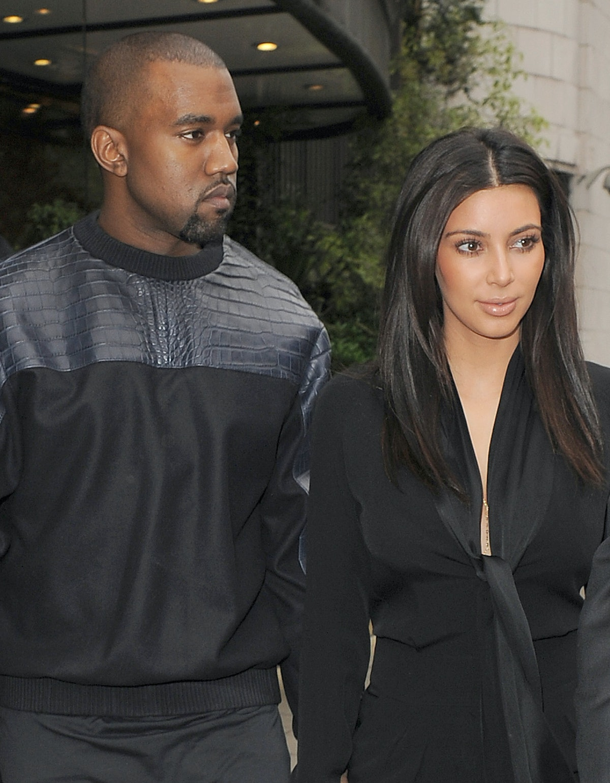 Kim Kardashian steps out with husband Kanye West.