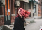 A young woman with purple and pink hair shows off her fall hair color, for which she'll need some In...