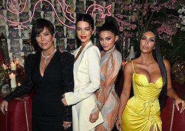 Kris Jenner, Kendall Jenner, Kylie Jenner, and Kim Kardashian pose for a photo.