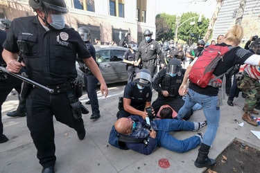The police beating a man.