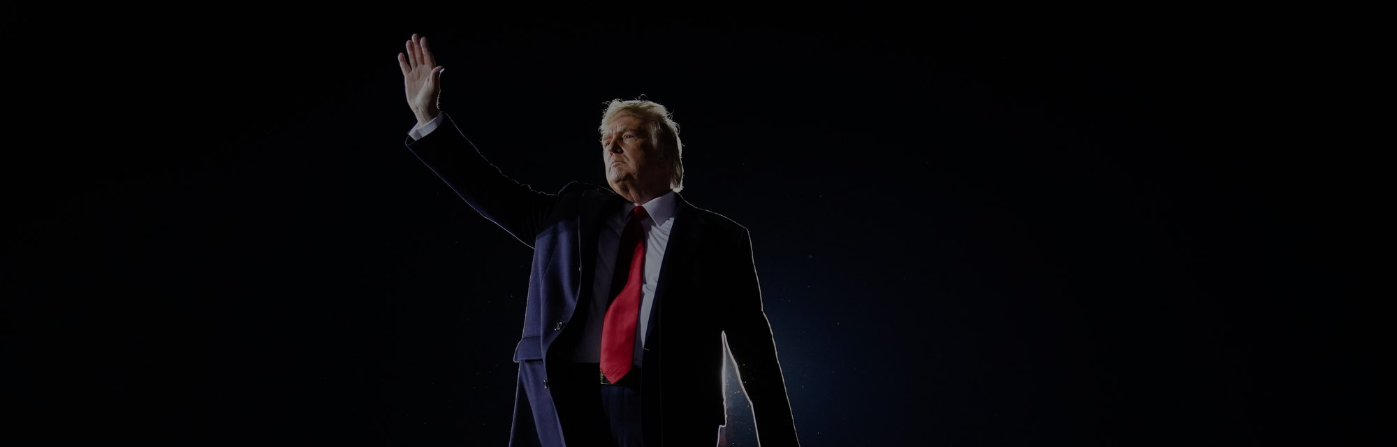 President Trump waving to supports at a campaign rally.