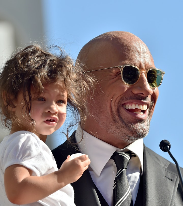 """Dwayne Johnson's daughter helps him """"clean"""" his muscles."""
