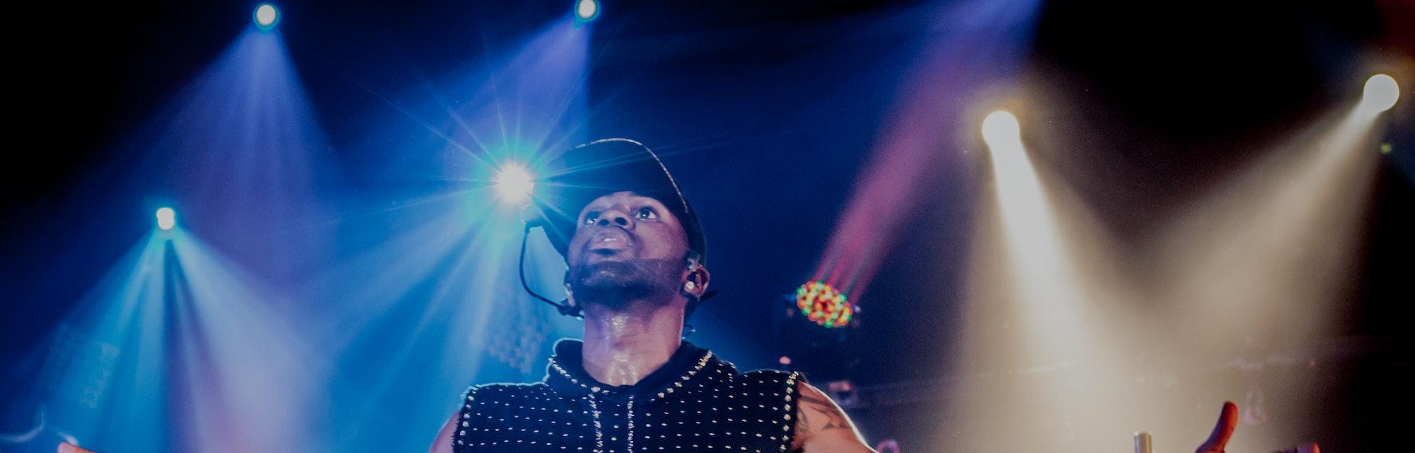 Jason Derulo performing at a concert.