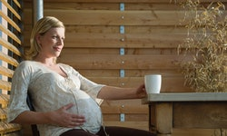 pregnant woman sitting at table