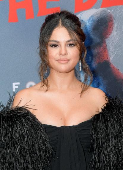 Selena Gomez wears her curtain bangs long and wavy.