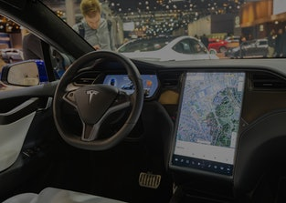 Interior of a Tesla Model X, showing its touchscreen that is prone to failure.