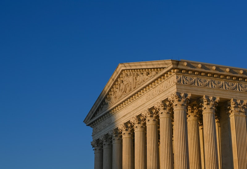 A perspective view of the Supreme Court. January 2021 shows 4 major reproductive rights cases going before SCOTUS or various circuit court of appeals.