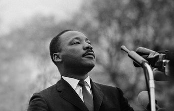 Dr. Martin Luther King, Jr. speaking before crowd of 25,000 Selma To Montgomery, Alabama civil rights marchers, in front of Montgomery, Alabama state capital building. On March 25, 1965 in Montgomery, Alabama.
