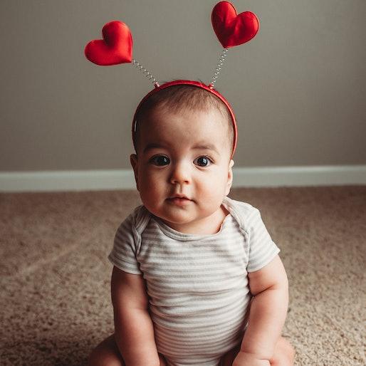baby sitting up wearing heat antennae