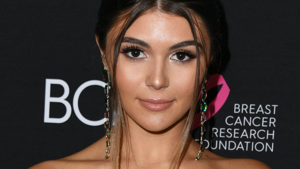 Olivia Jade hits the red carpet in a strapless dress.