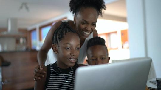 mom and kids at computer