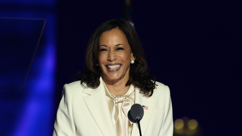 Kamala Harris steps up to the podium to make a speech.