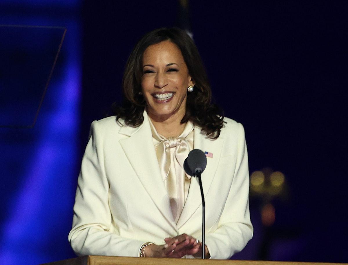Kamala Harris steps up to the podium to make a speech.