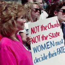 Two women hold a protest sign in support of Roe V. Wade, the 1973 Supreme Court decision legalizing abortion. Organizations to donate to on Roe V Wade's anniversary.