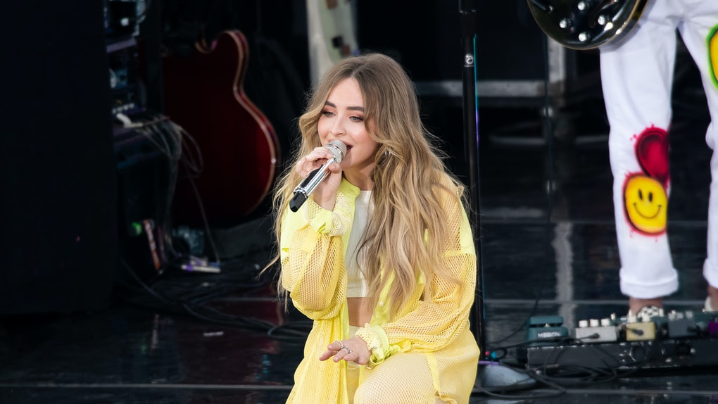 Sabrina Carpenter performs in a light yellow outfit.