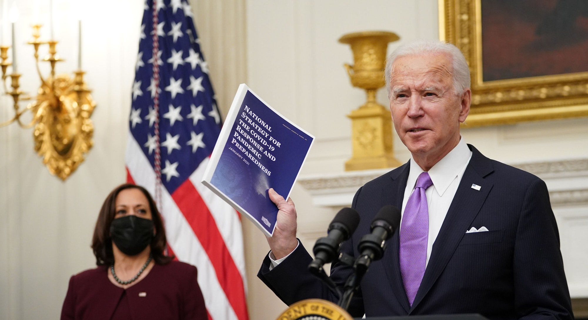 President Biden speaks while wearing a light purple tie. The Biden administration is creating new COVID safety standards for the country.