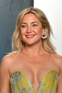 Actor Kate Hudson smiling in a green gown.